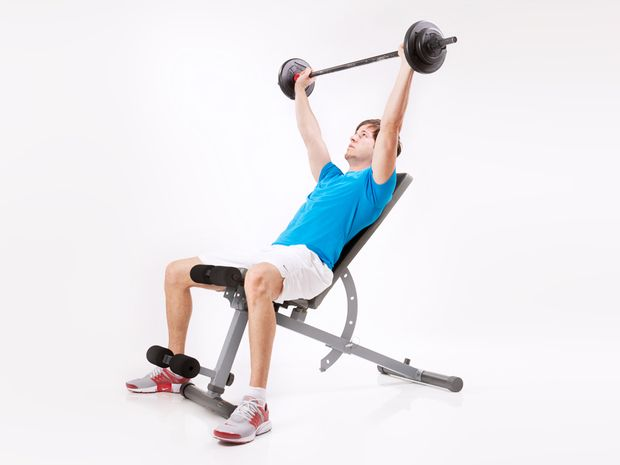 Bench press on the incline bench with barbell